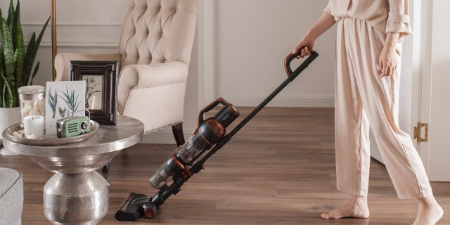 vacuuming the floor